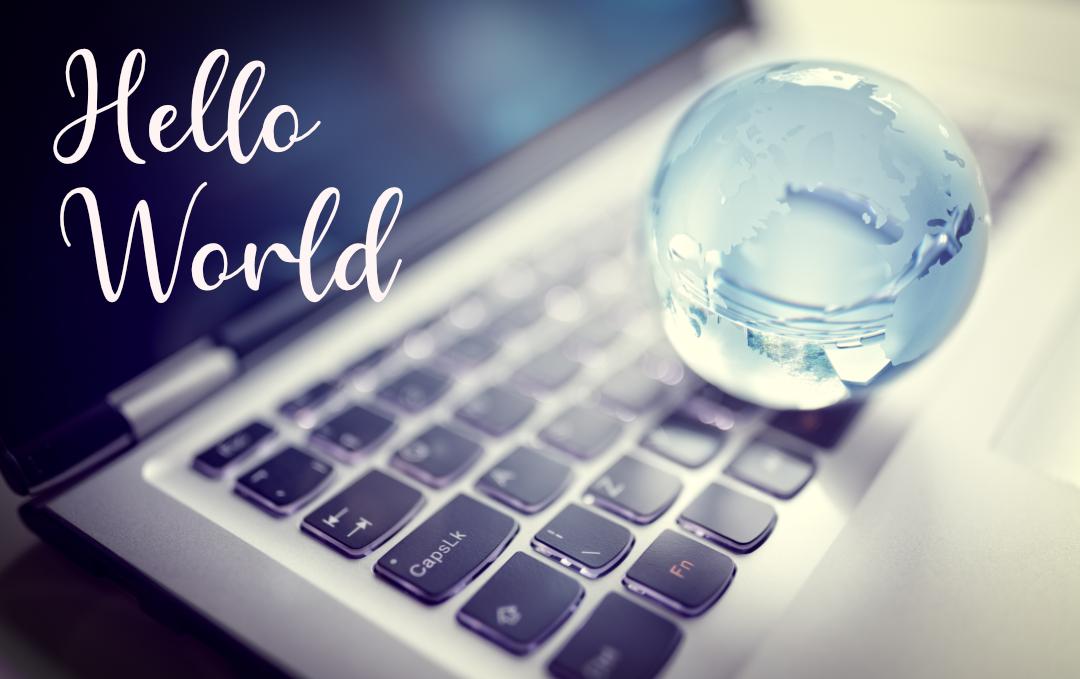 Glass globe sitting on laptop